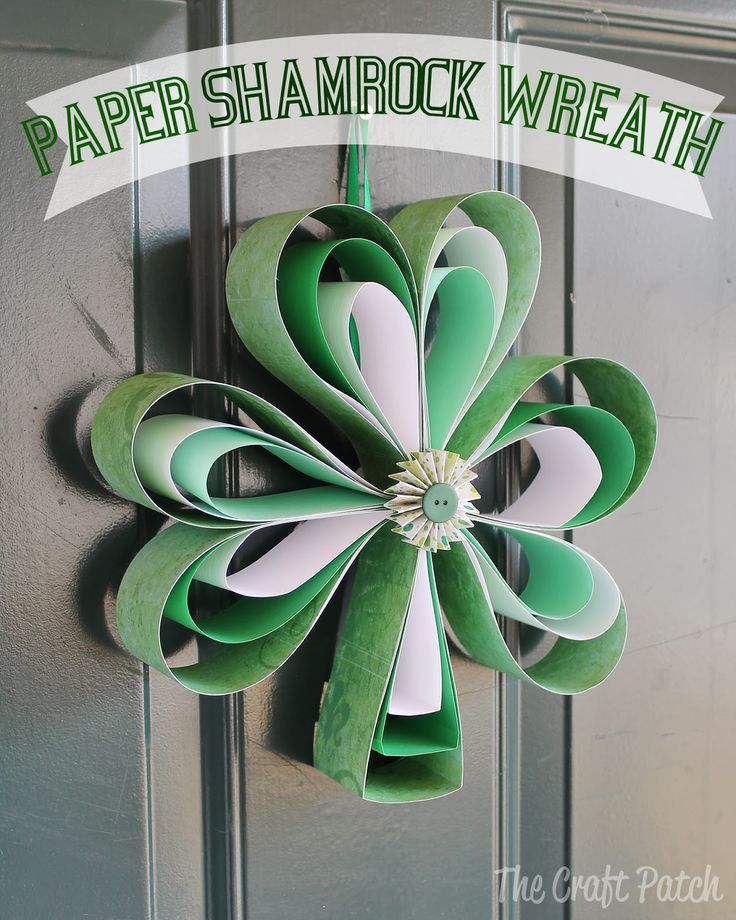 Shamrock wreath for St. Patrick's Day made entirely from scrapbook paper. Easy. cheap, cute! #diy