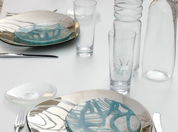 Restaurant Table Setting With Silver Glass Show Plates And Glass Dinner  Plates In Blue Design.
