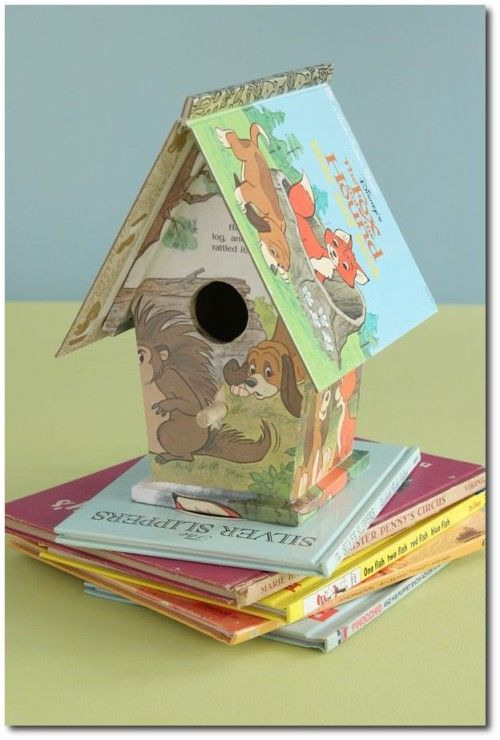 """Turn a craft store birdhouse into a """"fairy tale"""" bookhouse as a nursery gift. Use the jacket as the roof and decoupage the exterior with pages from the inside."""