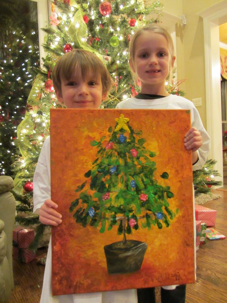 Handprint Christmas Tree on Canvas.  Used an idea from Pinterest but made a few changes.  Grandchildren made this for their mother, with a little help from Nana.  She loved it!