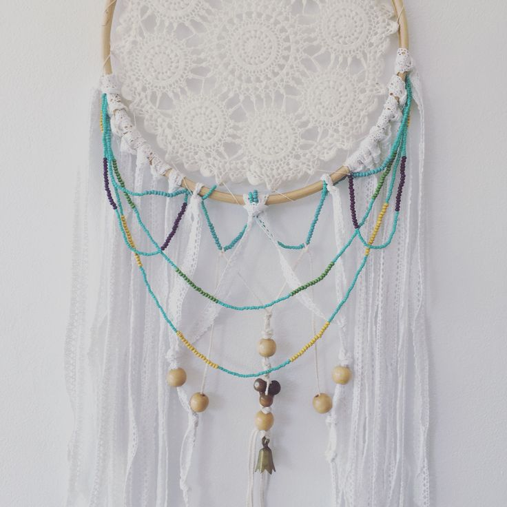 Hand beaded tail in a bohemian white dreamcatcher