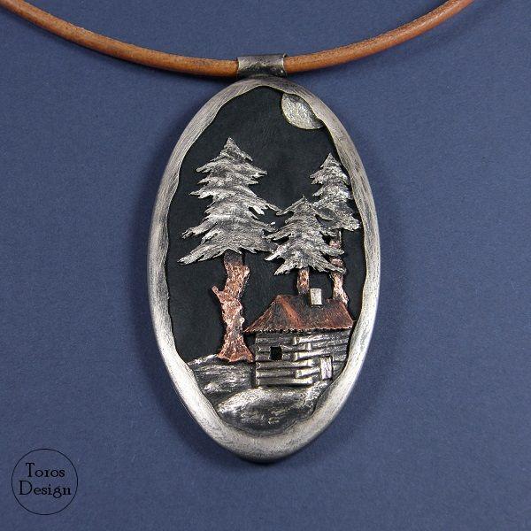 """Na leśnej polanie"". Srebrny wisior z miedzią na skórze. ""Forest landscape"". Silver, copper and leather  pendant."