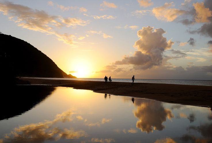 Picture of visitors walking along Grande Anse beach at sunset, Guadeloupe Islands