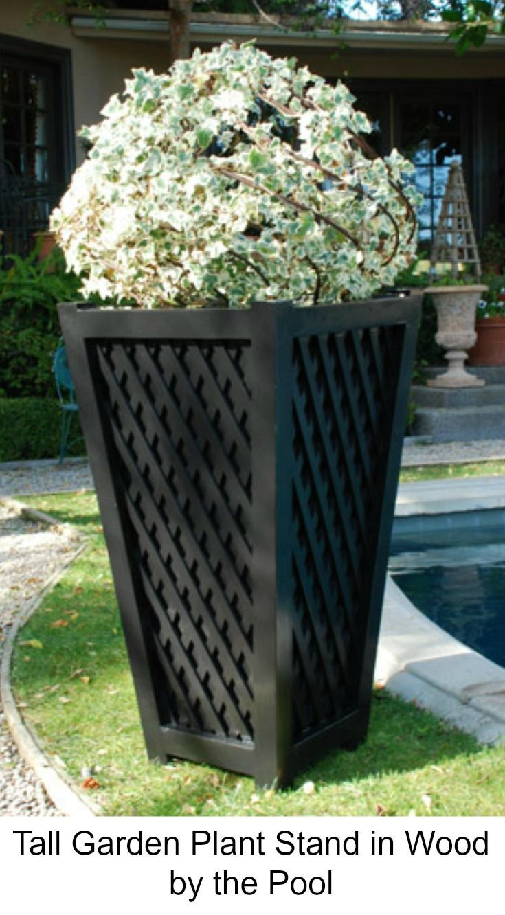 Tall Wood Plant Stand By The Garden Pool.
