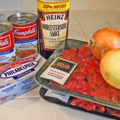 In the slow cooker stir in all the ingredients together, (except the meat AND the Cream Cheese).