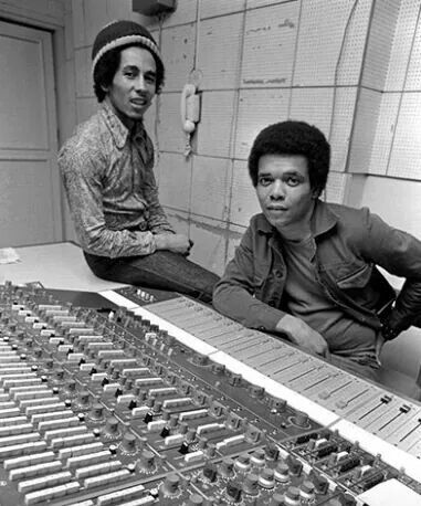 Bob Marley and Johnny Nash in the recording studio. This is SUCH a wonderful black and white vintage photo of the board, pinned via cabronwyn! #cSw:) - PROFESSIONAL RECORDING MUSIC PRODUCTION - https://www.pinterest.com/claxtonw/professional-recording-music-production/ - Don't miss the modern for that time telephone on the middle of the back wall.