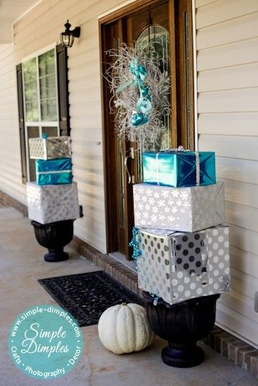 Front Porch Christmas Decor - Branch wreath and wrapped boxes on planters