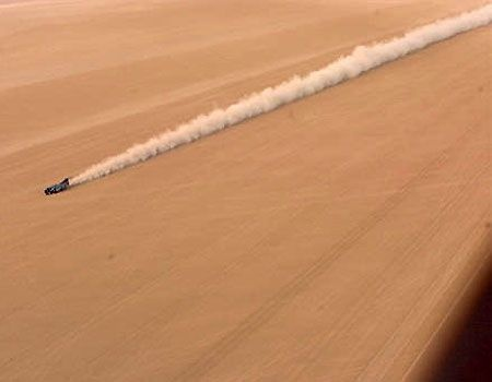 The Thrust SSC, current holder of the land speed record for a manned car, racing through the Jordanian desert.