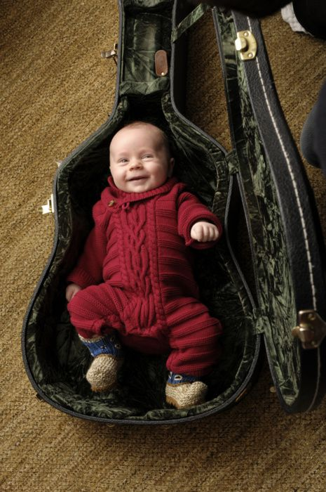 should we EVER decide to have a child, we will definitely have it's picture taken in the guitar cases!!!!  (eric church's baby)