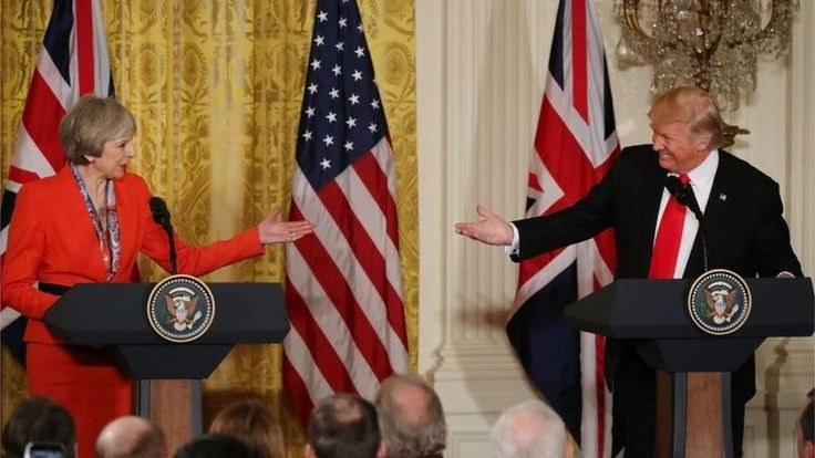 """US President Donald Trump and British Prime Minister Theresa May have reaffirmed their commitment to the Nato alliance after White House talks. Mrs May confirmed Mr Trump was """"100% behind Nato"""" despite the president's recent comments calling the transatlantic alliance obsolete. Both leaders said they would work to establish trade negotiation agreements. Mrs May also said Mr Trump had accepted an invitation from the Queen for a state visit later this year."""