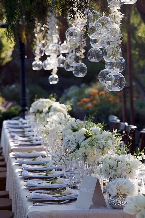 Love banquet styled tables with a small gap between tables for guests to move in between ....