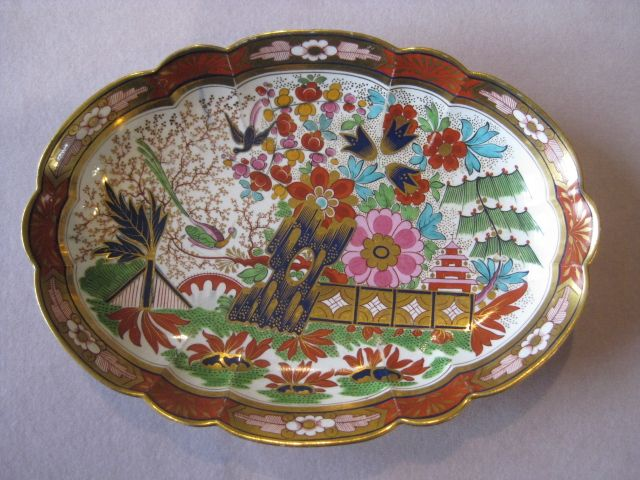 """No. 2726  A  Barr Flight & Barr Worcester  large shaped dish from a dessert service. The elaborate garden, pagoda and fence pattern in underglaze blue and overglaze enamels and gilt. BFB impressed & printed marks   Circa 1805  Diam.  11 1/8"""""""
