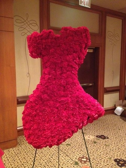 An awesome idea for a red dress event. Flowers in the shape of a dress!