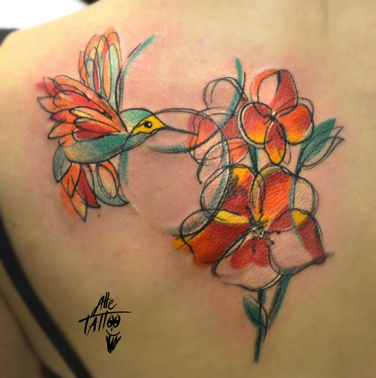 colibri bird with flowers done in avantgarde and watercolor style by alletattoo in alle tattoo shop freehand