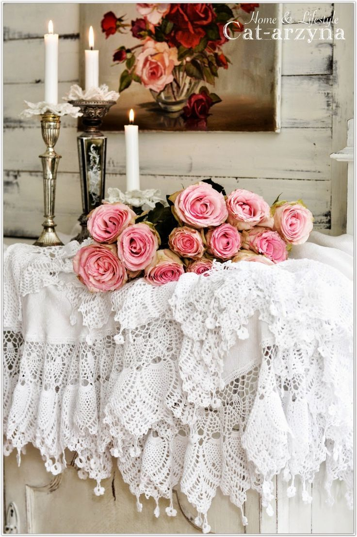 Shabby Chic lace table cloth with fresh flowers and vintage candle sticks