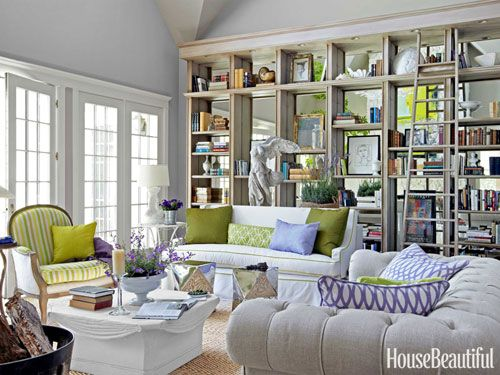 Mirrors installed along the back of the built-in shelving give the wall depth. Design: Stephen Shubel