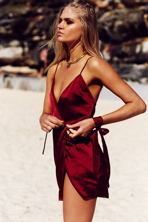 **RESTOCKING MID NOVEMBER, 2016***The luxurious Scarlett Wrap Dress is made from a high shine silky fabric in a port hue. It features a V neckline, thin straps, button closure inside dress and tie feature at side. Includes matching waist tie which can be worn as a choker. Exclusively designed by Sabo Skirt.