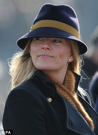 Autumn Phillips, March 12, 2014 in Gina Foster | The Royal Hats Blog