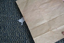 Place a sheet of brown paper bag (not plastic grocery kind) over the spot.