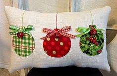 This lovely colorful Christmas pillow is a great addition to any holiday decor. It is made with ivory burlap and embellished with three round