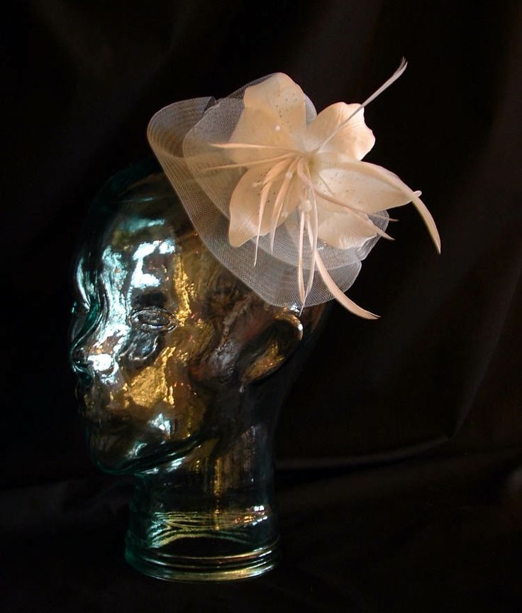 Crin, silk flower and feathers. $92 CAD (2013)