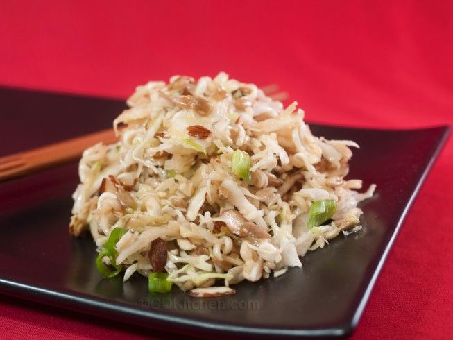 Asian Slaw - CDKitchen.com -  This overnight coleslaw calls for shredded cabbage, toasted almonds, sunflower seeds, ramen noodles, and a light vinaigrette.