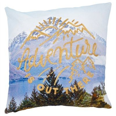 "Heed the call of your Great Canadian Adventure. Our cotton pillow cover boasts an eye-catching photo print of a still lake set amongst snow-capped mountains. Luxe gold embroidery reminds you that, ""Adventure is out there"". It reverses to a photo print back and is finished with a concealed zipper for easy care. Insert not included. 18"" x 18"". 100% cotton. Spot clean. Available only at Indigo."
