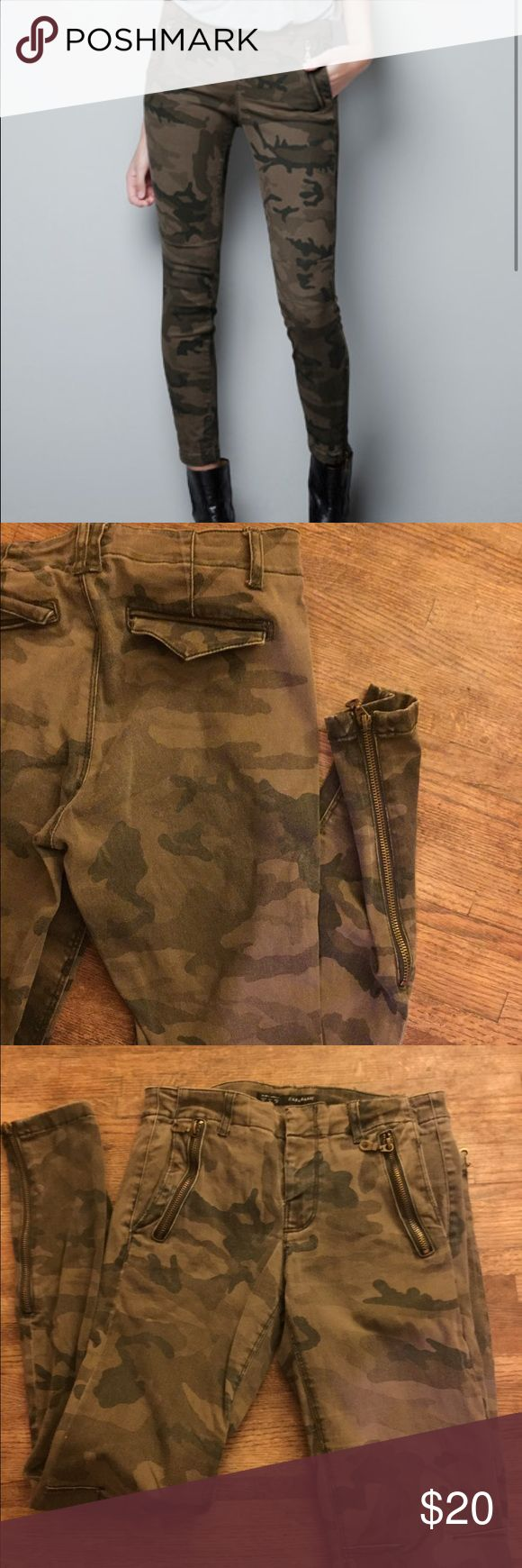 Zara Camouflage Skinny Pants Zara pants. Zipper on side of leg and front pockets. Hidden pockets with flap in back.  Tag says 4 but they fit like a 2 I would say around a 26 waist. Zara Pants Skinny