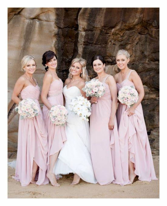 bride and bridesmaids in White Runway dresses for beachside wedding http://www.weddingchicks.com/2014/02/20/wedding-by-the-beach/