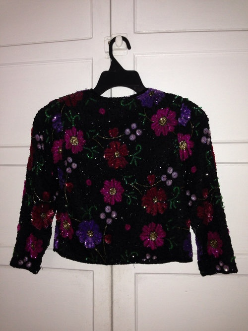 This cute and fun multi colored jacket is sure to turn heads. It can be used as fun cover up waist length jacket.