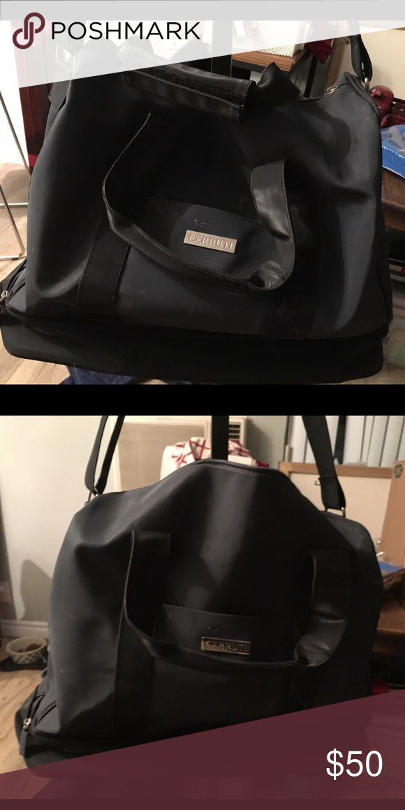 Cerruti Bag Black Cerruti bag that is used but in good condition! It's missing a zipper but that's easy to fix! Bags Luggage & Travel Bags