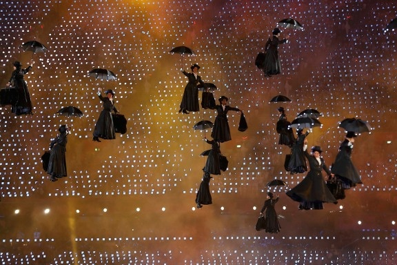 Performers dressed as the character Mary Poppins descend to the ground at the Olympic Stadium during the opening ceremony of the London 2012 Olympic Games on July 27, 2012.