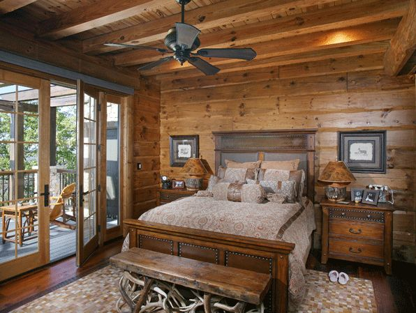 Rustic Cabin Bedroom; love the doors leading out to the deck; great idea for S.L. MBR library room......