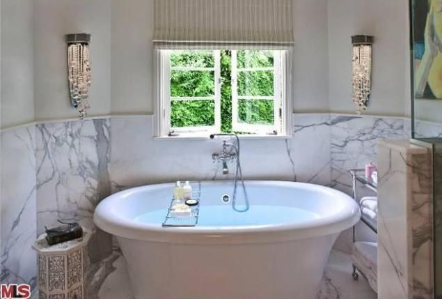 The bathroom comes complete with a giant soaking tub.