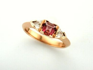 'KOKO' --   Tourmaline & Diamond  Engagement Ring set with Square Cut Rose Tourmaline  with Trillion Cut Diamonds with Knife Edge Shoulders.  Custom made in 18ct Rose Gold.