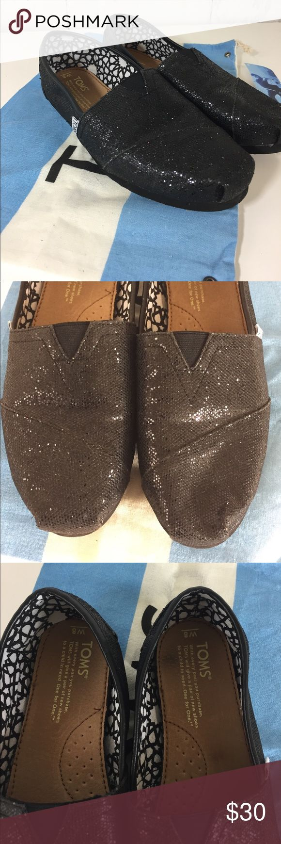 Black Glitter TOMS w/Dust Bag 8 Almost new pair of black sparkly TOMS with dust bag. They've only been worn a couple of times. Size 8 TOMS Shoes