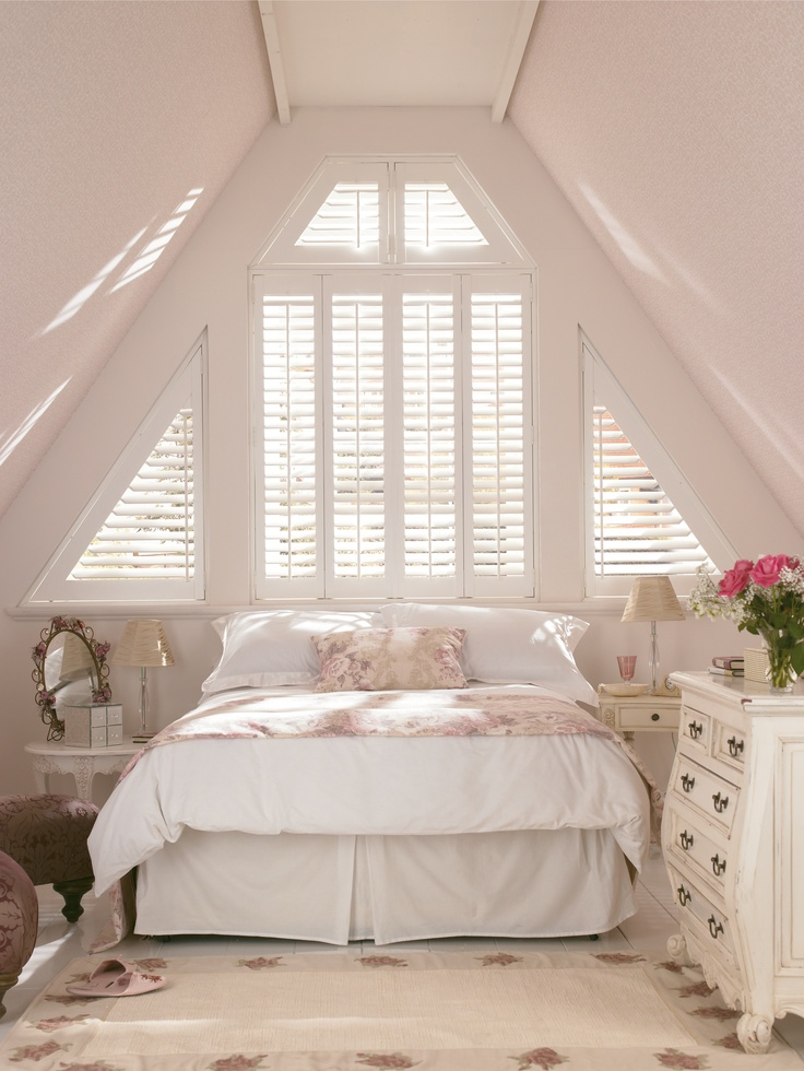 Bright white décor lighten up small rooms. Add creams and subtle patterns to bring the room to life. Made to measure shaped shutters would work wonderfully in this room. Perfect for bathrooms and bedrooms.