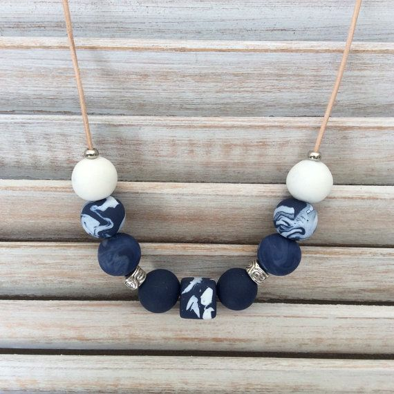 Handmade navy and white bead necklace. Each polymer clay bead has been individually hand rolled, giving them character. Included in the necklace