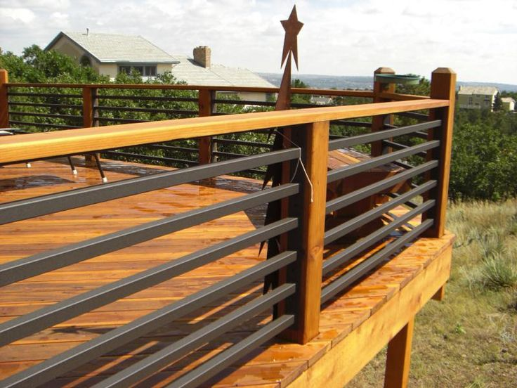 Metal Deck Railing Ideas View plenty Deck Railing Ideas http://awoodrailing.com/2014/11/16/100s-of-deck-railing-ideas-designs/