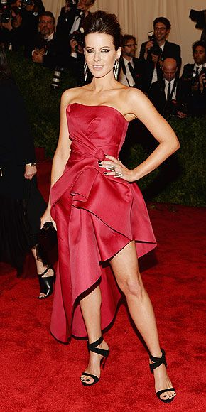 Stunning? Yes. Punk? Not so much. Actress Kate Beckinsale strikes a pose in a red silk strapless Alberta Ferretti gown with a gathered side and asymmetric hem and adds black strappy sandals, a matching Edie Parker clutch and some dramatic Lorraine Schwartz danglers at the Met Gala 2013.