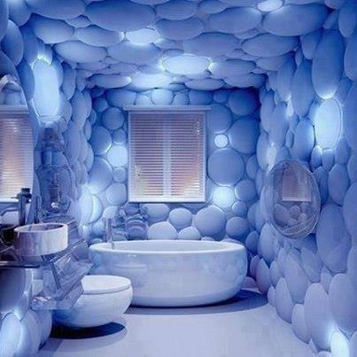 Blue themed bathroom creating a space of comfort with for Space themed bathroom