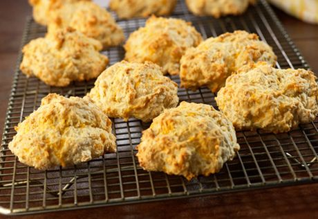 Chicken broth, garlic and shredded Cheddar cheese add great flavor to these tender and flaky biscuits.