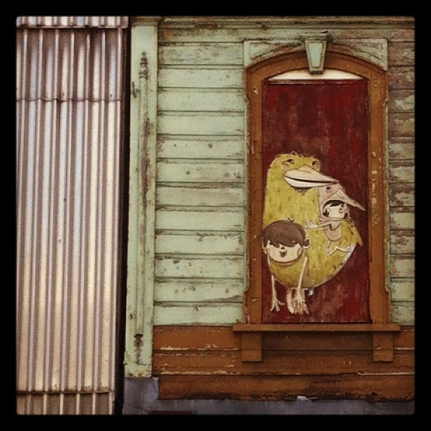 Street Art on window. Cuba Street. Wellington.