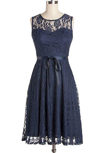 Elegant floral patterned lace dress in navy blue. Self tie waist sash. Back…