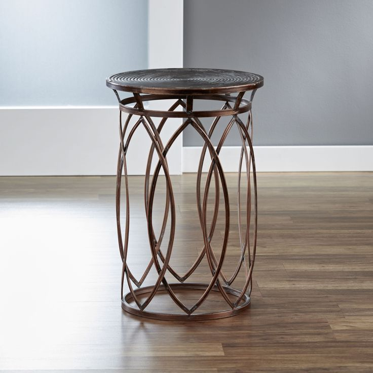 Inspire your living space with this round side table by InnerSpace, featuring an overlapping marquise design and coiled tabletop. Made of iron with an antique bronze patina finish that will enhance yo
