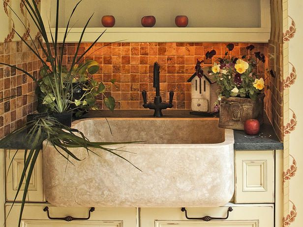 A large farmhouse sink in an area separate from the main kitchen is perfect for preparing flower arrangements or rinsing off muddy shoes.
