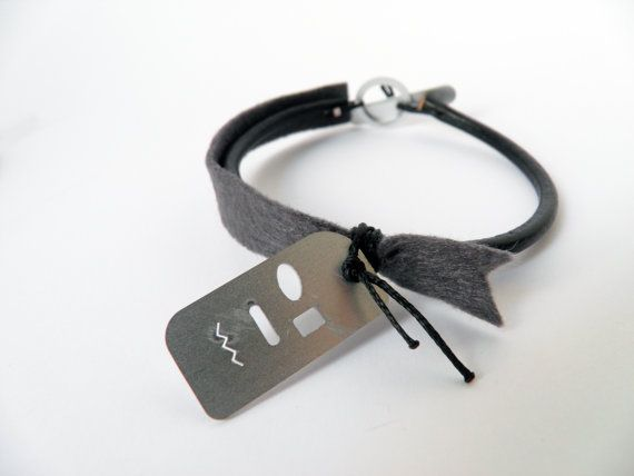 Leather bangle bracelet, cartoon face aluminum metal, grey felt, black wax thread. on Etsy, 27,00 €