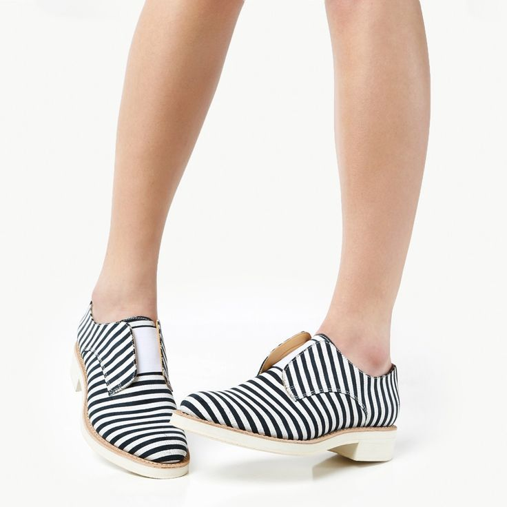 Women's navy and white striped oxford. Italian striped suede upper with  elastic closure.