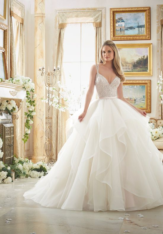 """Crystal beaded strappy, sweetheart bodice with a tulle and organza flounced ball gown skirt with satin waist band.  Colors Available:  White/Silver, Ivory/Silver, Blush/Silver (Shown).  Available in 3 lengths:  55"""", 58"""" 61""""."""
