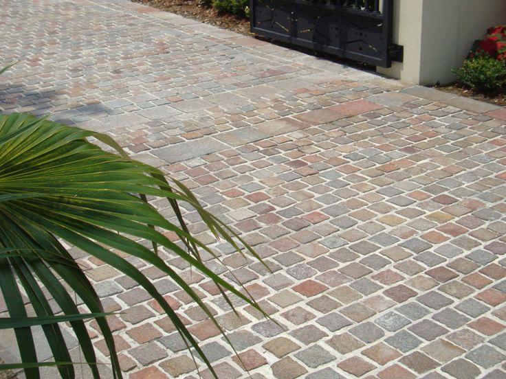 Eco Outdoor porphyry cobblestones driveway. Eco Outdoor | Porphyry cobblestones | livelifeoutdoors | Outdoor Design | Natural stone flooring | Garden design | Outdoor paving | Outdoor design inspiration | Outdoor style | Outdoor ideas | Luxury homes | Paving ideas | Garden ideas | Natural stone paving | Floor tiles | Outdoor tiles | Driveway